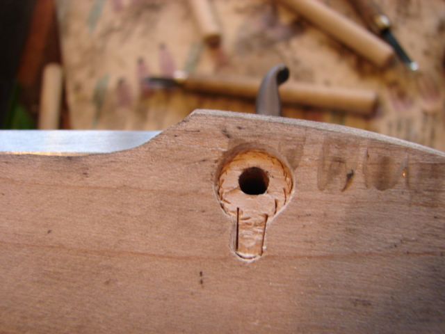 Use the chisel again to remove the next layer of wood.
