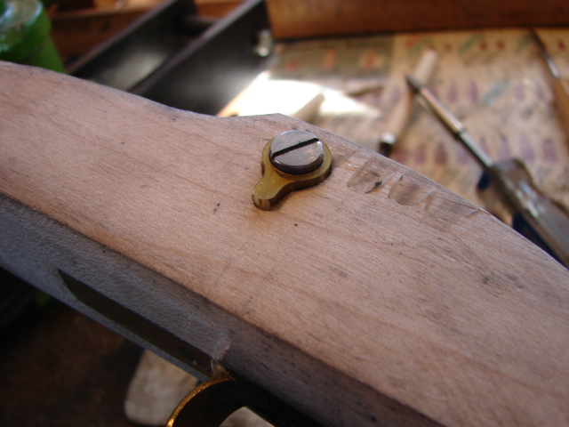 The side plate in the mortise.  It still needs to go deeper.